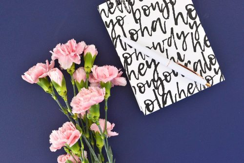 Multilingual notebook with pink flowers